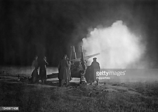 The crew of a British Army BL 4 point 5-inch medium field gun from an artillery regiment fire their gun in a night firing trial of army guns at the...