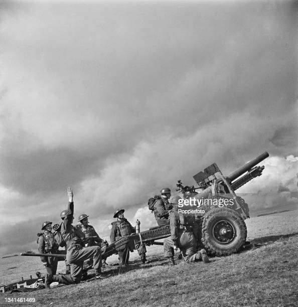 The crew of a British Army Ordnance QF 25-pounder field gun from the Royal Artillery prepare to fire their gun in training somewhere in England...