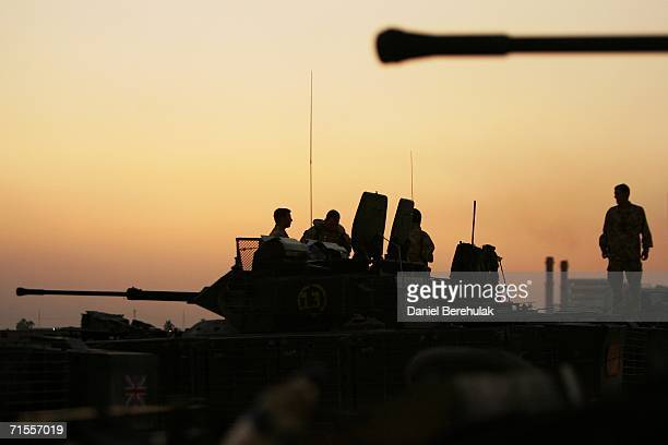The crew of a Warrior Armoured Fighting Vehicle from the Light Infantry Battle Group, based in the Shaat Al Arab Hotel, prepare for a patrol of Basra...