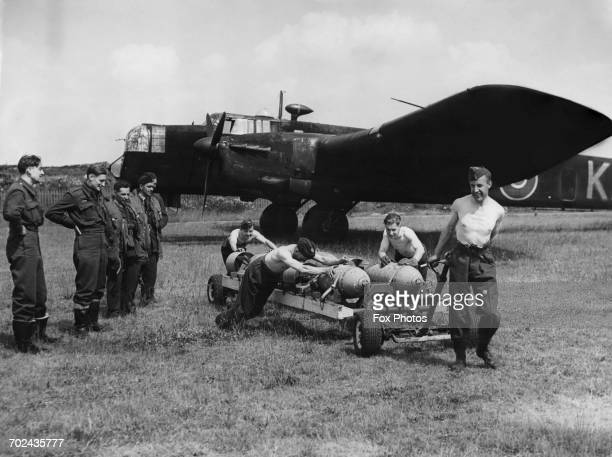 The crew of an Armstrong Whitworth Whitley MkV twinengine heavy bomber of No10 Operational Training Unit Squadron Royal Air Force Bomber Command look...