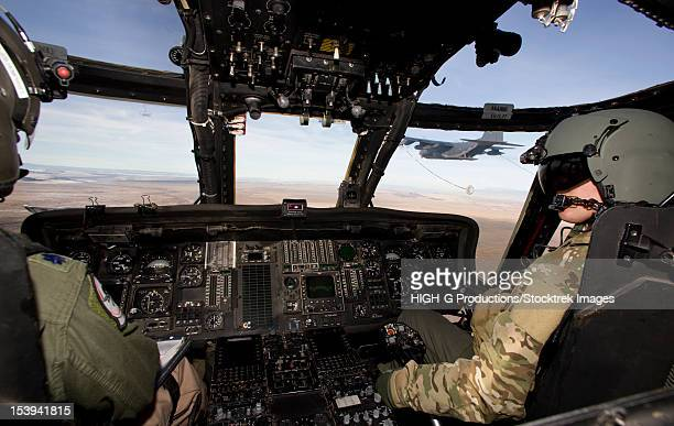 the crew of an hh-60g pave hawk prepare to conduct aerial refueling. - inside helicopter stock pictures, royalty-free photos & images