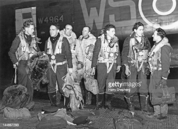 The crew of an RAF Lancaster bomber at a British airfield on their return from an overnight raid on Stettin Poland 6th January 1944 This aircraft was...