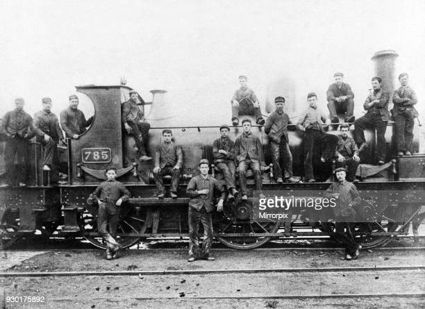 The crew of an steam locomotive pose beside the engine at Stafford Road sheds circa 1900