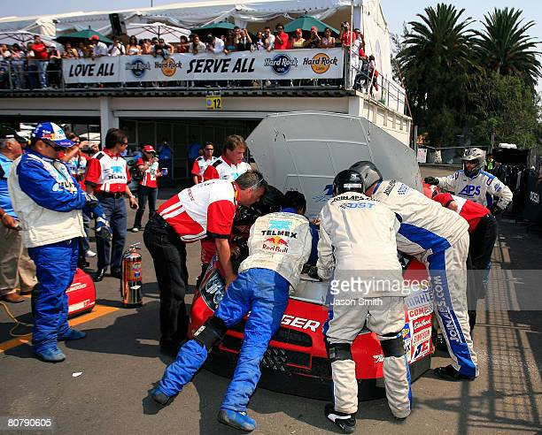 The crew of Antonio Perez driver of the Chivas RacingTELMEX Dodge attends to the car on pit road during the NASCAR Nationwide Series Corona Mexico...
