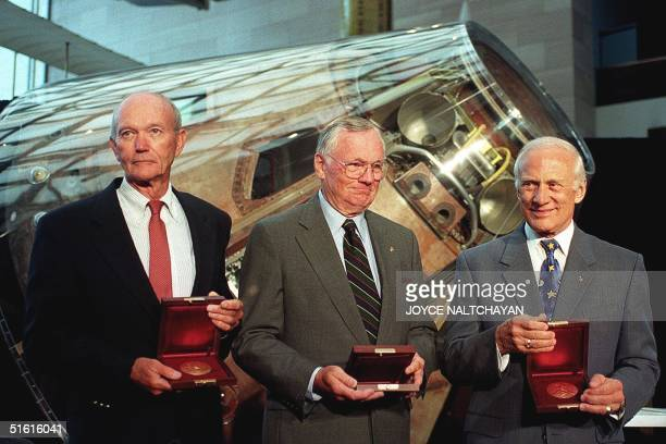 The crew of Apollo 11 Michael Collins , Neil Armstrong and Buzz Aldrin stand in front of the Apollo command module Columbia after US Vice President...