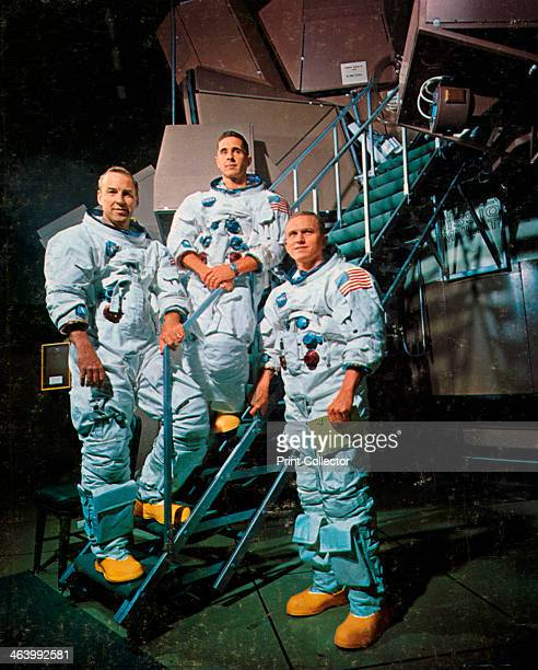 The crew of Apollo 8 in front of a simulator 1968 From left to right James A Lovell Jr William A Anders and Frank F Borman II