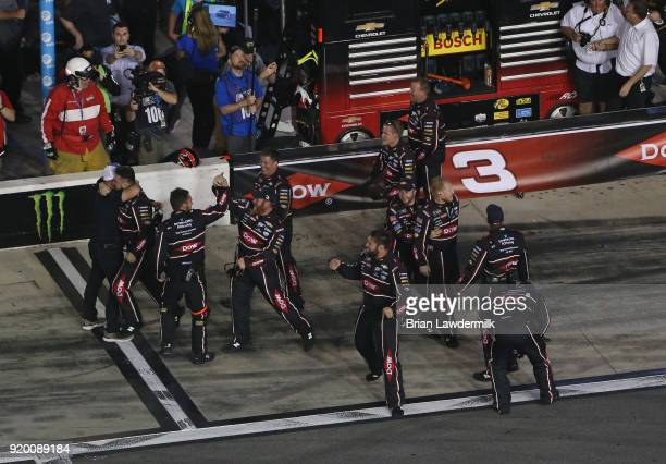 The crew of Austin Dillon driver of the DOW Chevrolet celebrate winning the Monster Energy NASCAR Cup Series 60th Annual Daytona 500 at Daytona...