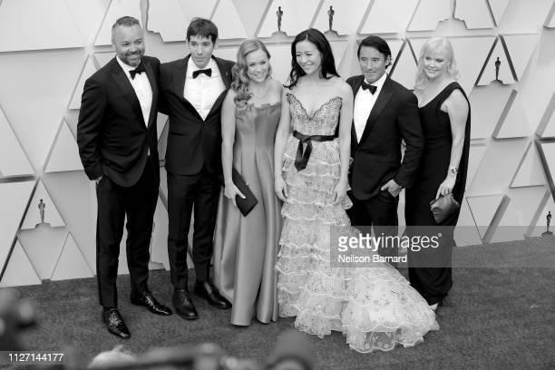 The crew of Best Documentary nominees for 'Free Solo' including climber Alex Honnold Elizabeth Chai Vasarhelyi Jimmy Chin attends the 91st Annual...