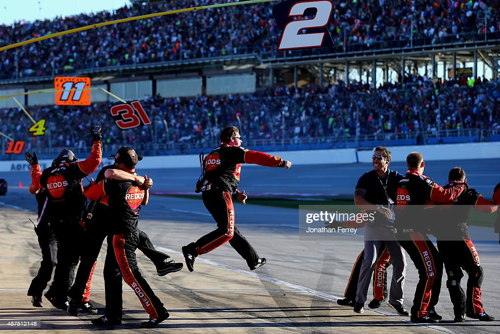 The crew of Brad Keselowski, driver of the #2 Redd's Wicked Apple Ale Ford, celebrates after winning the NASCAR Sprint Cup Series GEICO 500 at Talladega Superspeedway on October 19, 2014 in Talladega, Alabama.