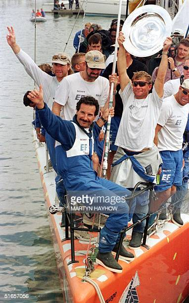 The crew of EF Language the Swedish yacht skippered by Paul Cayard of the US celebrate after arriving at Southampton in second place of the last leg...