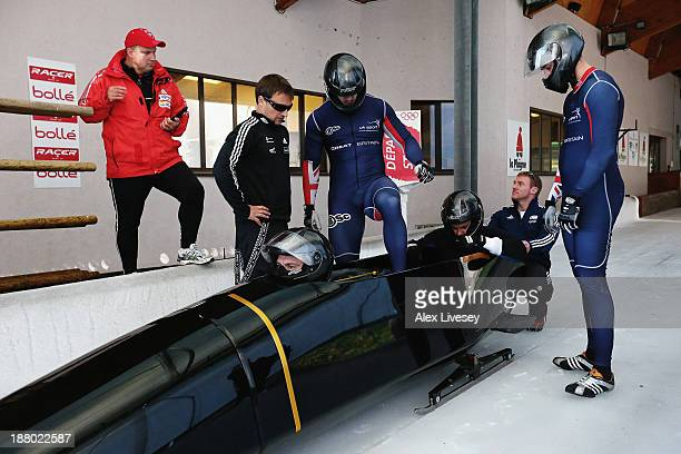 The crew of GBR1 John Jackson Bruce Tasker Stu Benson and Craig Pickering of the Great Britain bobsleigh team prepare for a training run at La Plagne...