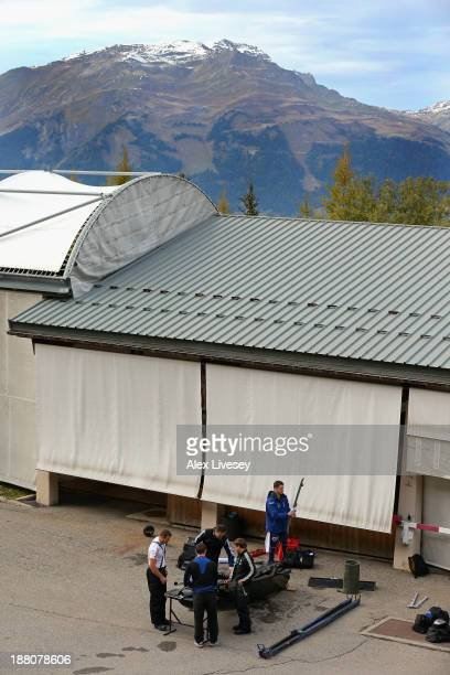 The crew of GBR1 John Jackson Bruce Tasker Stu Benson and Craig Pickering of the Great Britain bobsleigh team work on their bobsleigh after a...
