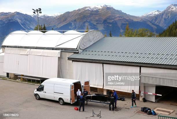 The crew of GBR1 John Jackson Bruce Tasker Stu Benson and Craig Pickering of the Great Britain bobsleigh team load up their bobsleigh in to a van...