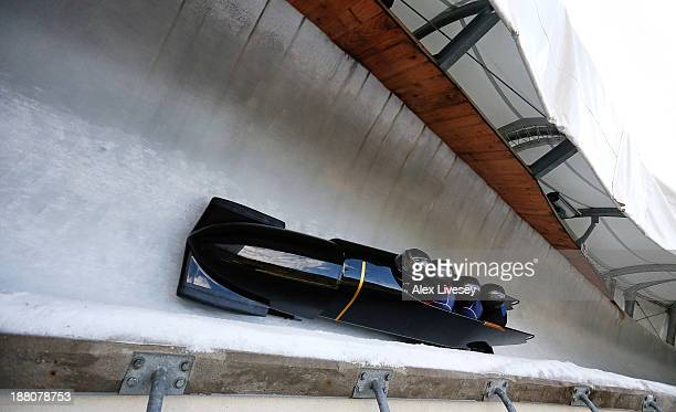 The crew of GBR1 John Jackson Bruce Tasker Stu Benson and Craig Pickering of the Great Britain bobsleigh team take a bend during a training run at La...
