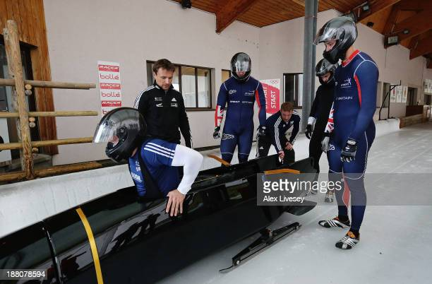 The crew of GBR1 John Jackson Bruce Tasker Stuart Benson and Craig Pickering of the Great Britain bobsleigh team prepare for a training run at La...