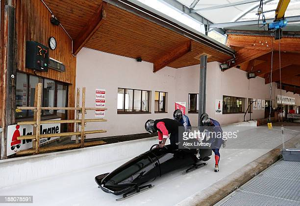 The crew of GBR2 Lamin Deen John Baines Andy Matthews and Toby Olubi of the Great Britain bobsleigh team start their run during a training run at La...