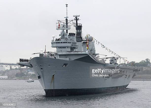 The crew of HMS Arkroyal salute Queen Elizabeth II during the International Fleet Review on June 29 2010 in Halifax Canada The Queen and Duke of...