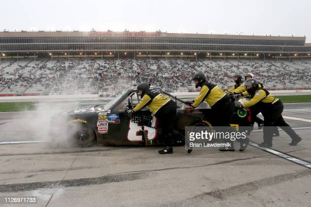 The crew of Joe Nemechek driver of the Chevrolet pushes the truck down pit road during the NASCAR Gander Outdoors Truck Series Ultimate Tailgating...