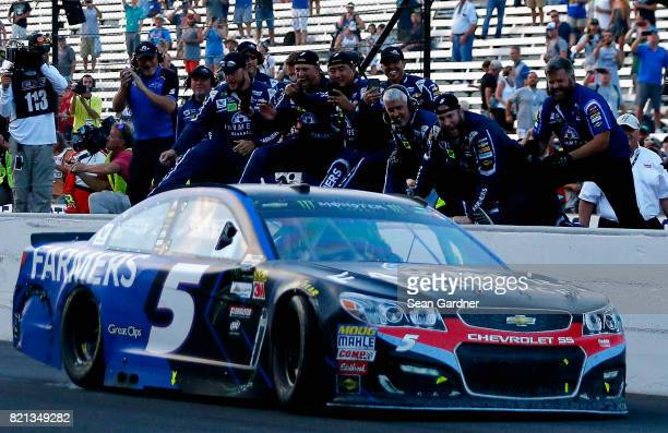 The crew of Kasey Kahne driver of the Farmers Insurance Chevrolet celebrates after winning the Monster Energy NASCAR Cup Series Brickyard 400 at...