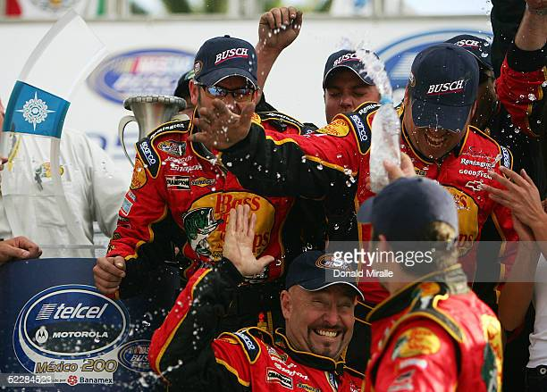 The crew of Martin Truex Jr., driver of the Bass Pro Shops Chevrolet Monte Carlo, celebrates his victory during the Telcel Mexico 200 Nascar Busch...