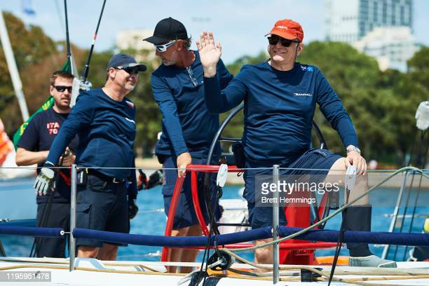 The crew of Maserati wave as they sail from the CYCA during the 2019 Sydney to Hobart on December 26 2019 in Sydney Australia