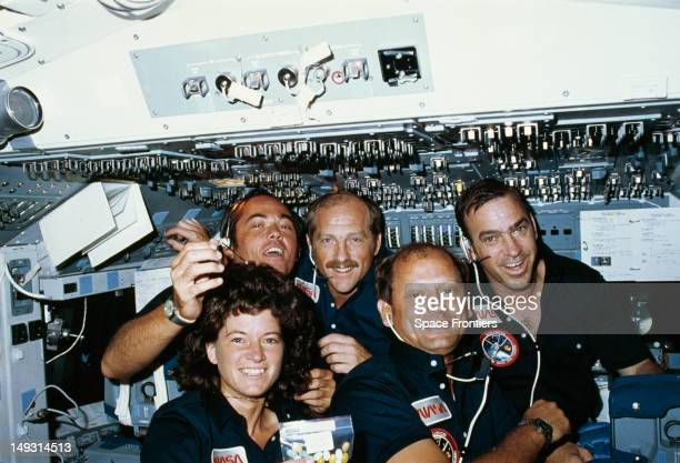 The crew of NASA's STS7 space mission in space June 1983 From left to right they are Robert L Crippen Frederick H Hauck and John M Fabian Sally Ride...