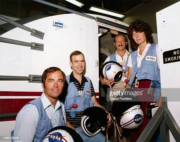The crew of NASA's STS7 space mission on the steps of the Shuttle Mission Simulator during training at the Johnson Space Center in Houston Texas 23rd...