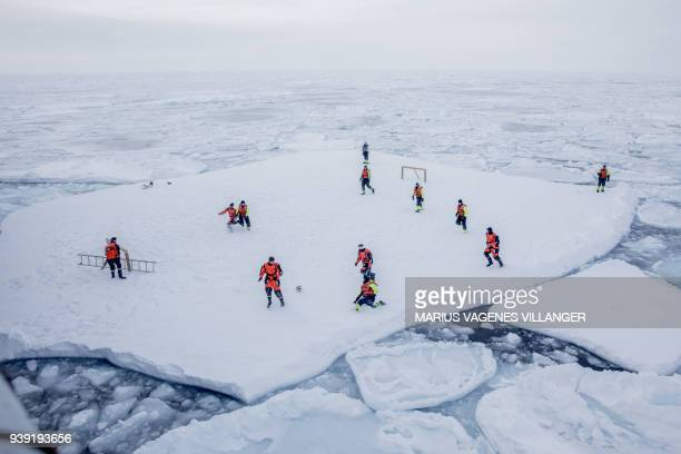 The Crew of patrol vessel KV Svalbard and scientists from the Norwegian Institute of Marine Research play football on ice offshore, on March 22, 2018...