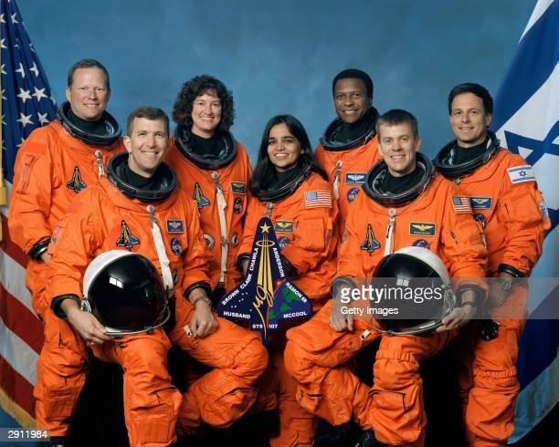 The crew of Space Shuttle Columbia's mission STS107 take a break from their training regime to pose for the traditional crew portrait Seated in front...