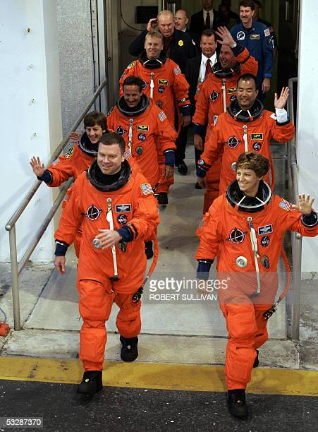 The crew of Space Shuttle Discovery pilots James Kelly Commander Eileen Collins followed by mission specialists Wendy Lawrence Charles Camarda Andrew...