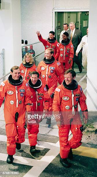 The crew of Space Shuttle Mission STS47 walks out of the crew quarters to the waiting bus that will transport them several miles to the launch pad