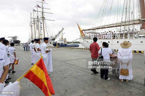 The crew of Spain's sailboat Juan Sebastian de Elcano is welcomed by sailors relatives and other people at the port of Guayaquil Ecuador during the...