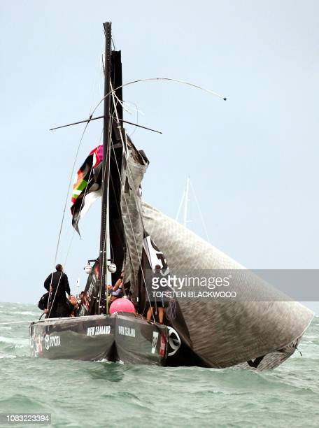 The crew of Team New Zealand NZL82 skippered by Dean Barker struggles to secure the broken mast and rigging during a dramatic climax of the seventime...