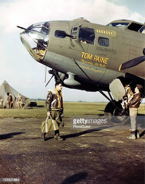 """The crew of the B-17 Flying Fortress bomber """"Tom Paine"""" prepare for a mission, England, mid-1940s. When the men of an 8th Air Force group gave the..."""