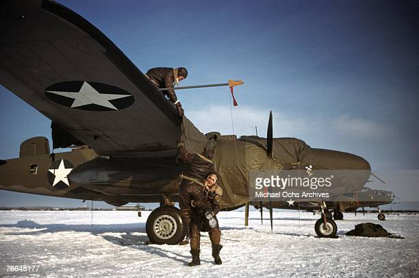 The crew of the B24 Liberator 'Casa De Lobos' prepare their plane for takeoff at a United States Army Air Force base in December 1942 in Goose Bay...