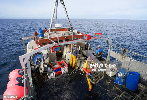 The crew of the Harvester II fishing trawler working four miles off The Manacles rocks on March 17, 2021 in Falmouth, Cornwall, England. The owners...