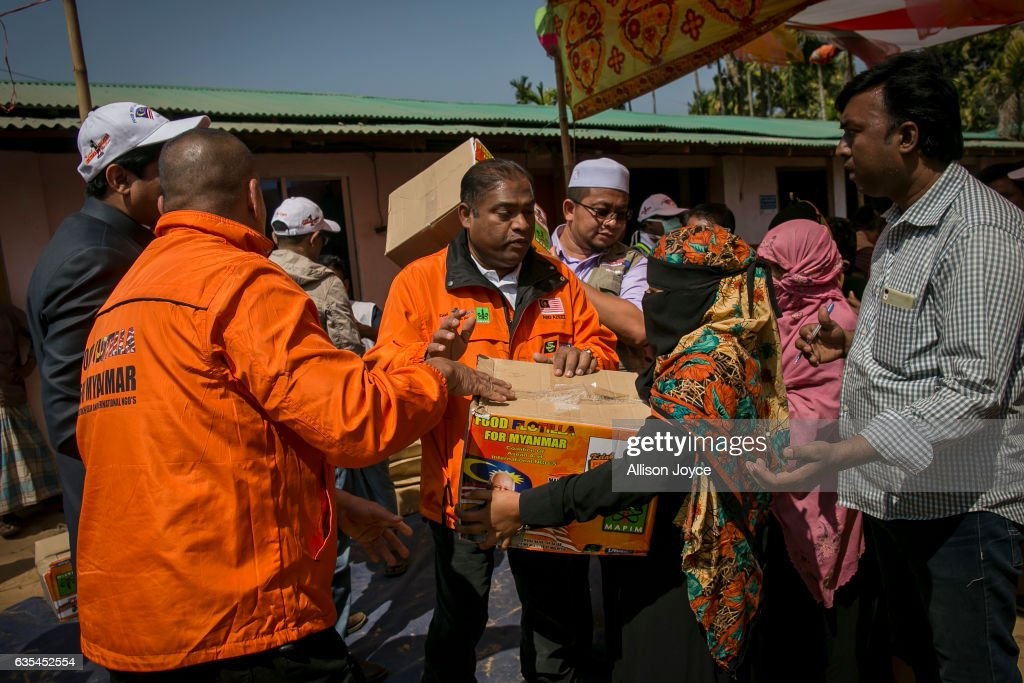 The crew of the Nautical Aliya provides relief to Rohingya refugees on February 15, 2017 in Chittagong, Bangladesh. The Rohingya aid ship, Nautical Aliya, carrying 2,200 tons of rice, emergency supplies and aid-workers, docked at Chittagong Port, about 140km from Cox's Bazar where thousands of Rohingya Muslims have taken refuge. Around 70,000 Rohingya Muslims have fled to Bangladesh from Myanmar since October last year after the Burmese army launched a campaign it calls 'clearance operations' in response to an attack on border police. According to reports, Bangladesh plans to proceed with a controversial plan to relocate tens of thousands of Rohingya refugees from Myanmar to a remote island in Bay of Bengal, despite warnings it is uninhabitable and prone to flooding. The Rohingya, a mostly stateless Muslim group numbering about 1.1 million, are the majority in Rakhine state and smaller communities in Bangladesh, Thailand and Malaysia.