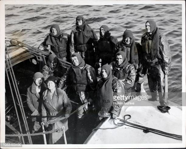The crew of the new lifeboat at Falmouth, with Mrs G. Chellew , President of the Ladies Lifeboat Guild, UK. The lifeboat came from Yarmouth on the...