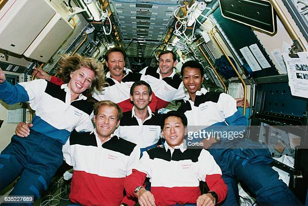 The crew of the shuttle Endeavor on STS47 Jay Apt is center Clockwise from right is Dr Mae Jemison Mamoru Mohri of Japan Mark Lee and his wife Dr N...