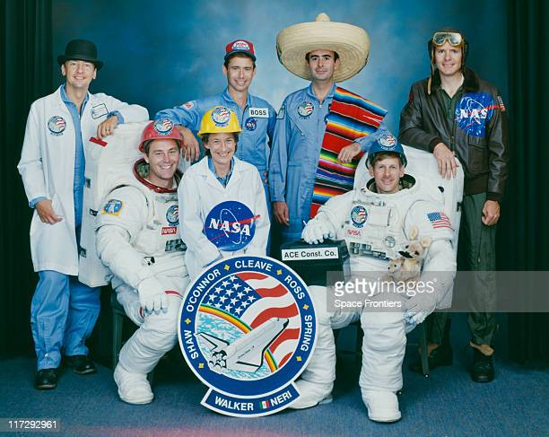 The crew of the Space Shuttle Atlantis mission STS61B wearing various novelty hats 1985 Left to right Charles D Walker Jerry L Ross Mary L Cleave...