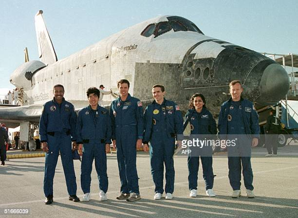 The crew of the space shuttle Columbia Winston Scott of the US Takao Doi of Japan mission Commander Kevin Kregel of the US Leonid Kadenyuk of Ukraine...