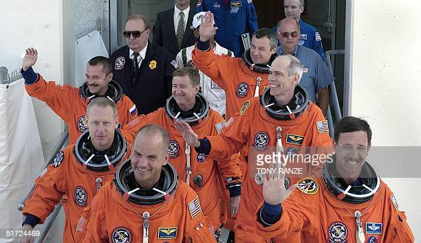 The crew of the space shuttle Discovery depart the Operationas and Checkout Building and head to launch pad 39A at the Kennedy Space Center 09 August...