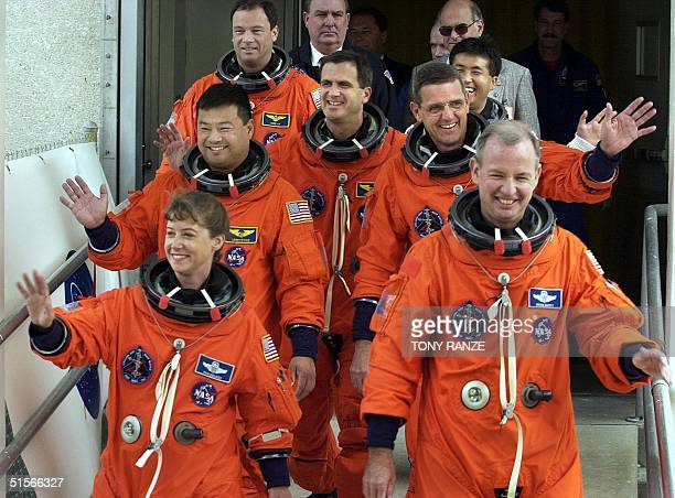 The crew of the space shuttle Discovery Pilot Pamela Melroy Commander Brian Duffy Mission Specialist Leroy Chiao Mission Specialist William McArthur...