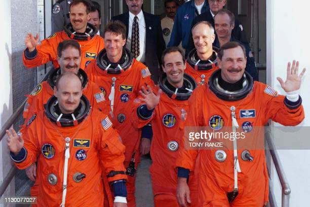 The crew of the Space Shuttle Discovery Pilot Scott Kelly Commander Curt Brown Mission Specialist John Grunsfeld Mission Specialist C Michael Foale...