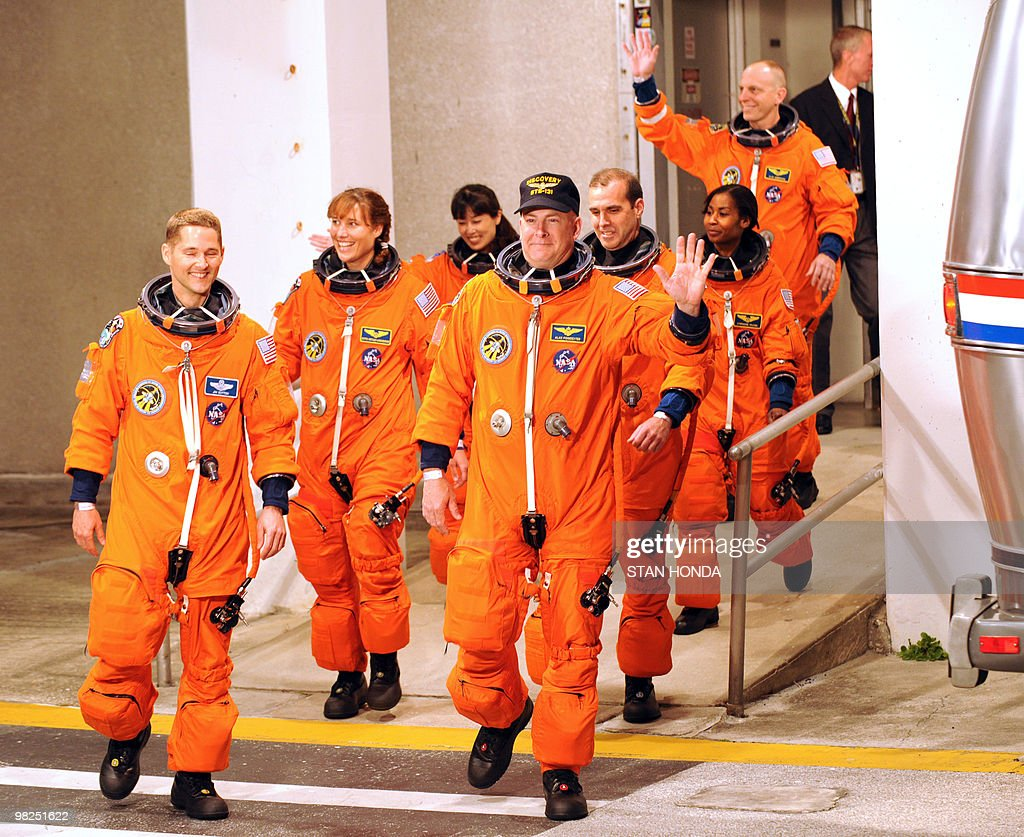 The crew of the space shuttle Discovery walks out to the astrovan early on April 5, 2010 at Kennedy Space Center in Florida in advance of the early morning launch. Pictured are (from L to R) pilot Jim Dutton, mission specialists Dorothy Metcalf-Lindenburger, Naoko Yamazaki of the Japan Aerospace Exploration Agency, commander Alan Poindexter, Rick Mastracchio, Stephanie Wilson and Clay Anderson (rear). Discovery will carry a multi-purpose logistics module filled with science racks for the laboratories aboard the International Space Station. AFP PHOTO/Stan HONDA