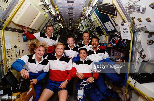 The crew of the space shuttle Endeavour poses for a photo in the Spacelab module in the shuttle's cargo bay Jan Davis's long hair floats upward in...