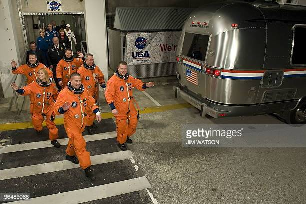 The crew of the space shuttle Endeavour STS130 walk out to the astrovan for the second time in two days at Kennedy Space Center in Cape Canaveral...