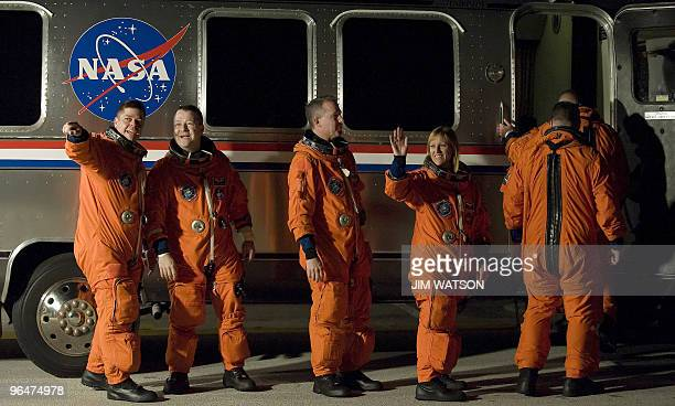 The crew of the space shuttle Endeavour STS130 wave as they board the astrovan at Kennedy Space Center in Florida on February 7 2010 in advance of...