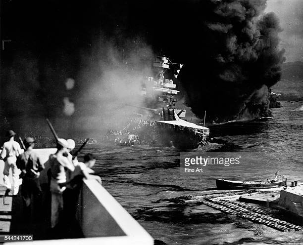 It's crew is forced to abandon the USS California during the Japanese attack on Pearl Harbor Hawaii December 7 1941 Silver print Navy photographer...