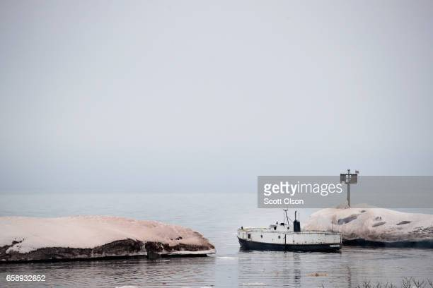 The crew of the Three Suns fishing boat heads out to check nets on Lake Superior from Black River Harbor on March 27, 2017 near Ironwood, Michigan....